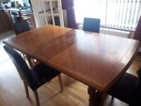 Wooden Expanding dining table and chairs
