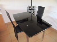 Extendable Black Glass Table & 2 Chairs