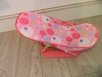 Pink bath support and blue tummy tub