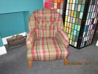 Tartan button backed armchair