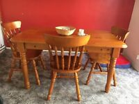 Pine dinning room table and chairs