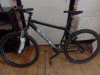 """Saracen Tufftrax Mountain Bike - Adult size with 26"""" wheels with front suspension"""