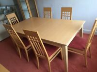 John Coyle Extending Dining Table and 6 Chairs. Beech Finish .