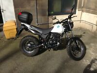 Hyosung RT 125 ... real big bike feel ..... 13 months warranty...... only done 1700 miles