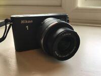 Nikon 1 J1 (w/ 10-30mm lens, 8GB memory card & carrying case)