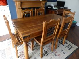 Rustic heavy duty dark wood dining room table and 6 chairs with seat pads. Used but solid condition.