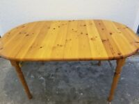 Solid pine dining room table and 6 chairs
