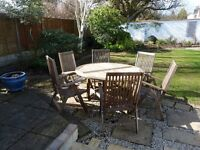 Teak table and folding chair set