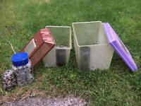 Two plastic fish / amphibian tanks with tunnel and stones