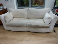 Large cream-coloured sofa