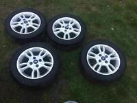 """Set of 4 15"""" Ford alloy wheels with new tyres"""