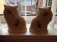 Old fashion China cats with flowers on