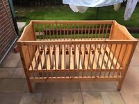 Antique pine looking baby cot .