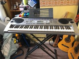 Casio LK-73 Keyboard and stand.
