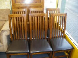 BIG HEAVY EXTENDING TABLE AND 6 MATCHING CHAIRS