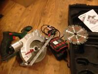 CORDLESS CIRCULAR SAW WITH CASE, IN FULL WORKING ORDER AND 2 CUTTING BLADES