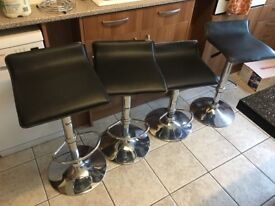 4 black leather affect stools