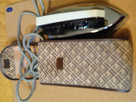 Iron: craft/travel iron, foldable handle +carry case, no steam, knitting or newspaper rack/ holder