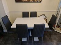 White modern extending dinning table and 6x grey leather chairs