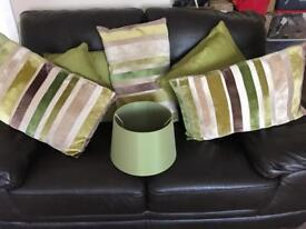 Green accessories. Cushions, lampshade and rug