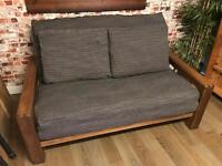 Beautiful solid wood two seat futon frame, mattress, cover & pillows, great cond. by Futon company
