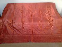 Orange satin quilted bedspread