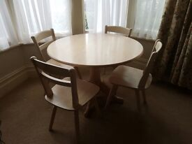 4 seater round dining table and 4 chairs