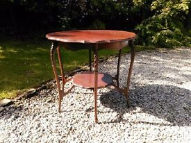 Occasional table. Pretty shaped top and shelf underneath.