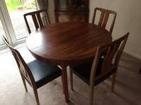 Extendable Wooden dining room table and four chairs