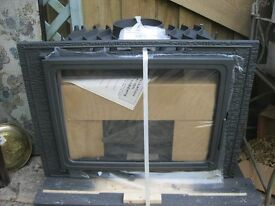 NEW, IN ORIGINAL PACKAGING, 'FOYER 700 ECO' MULTI FUEL HEATER. ORNATE BLACK CAST. VIEWING/DELIVERY