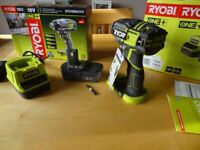 As new, boxed Ryobi 18v impact driver with charger and battery