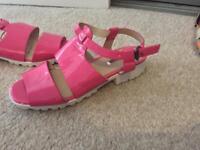 Girls pink sandals.