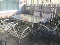 GLASS PATIO TABLE & 6 CHAIRS