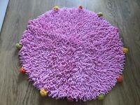 Round pink bath mat
