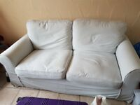 White 2/3 seater sofa in good condition (some wear and tear), detachable cushion covers, comfortable