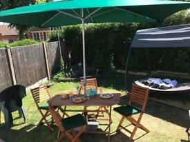 Garden table with chairs and umbrella