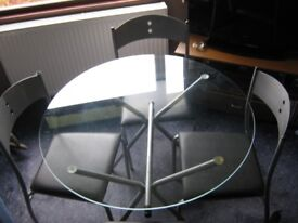 CIRCULAR GLASS TOPPED TABLE AND 4 CHAIRS