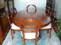 Extending Dining table with 6 matching chairs in Cherry Wood