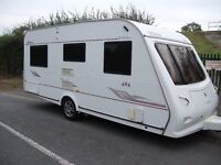 **ELDDIS ODYSSEY 484 FIXED BED 4 BERTH CARAVAN WITH POWERTOUCH MOVER, TWIN SUNROOFS ETC**
