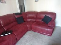 Red soft leather conner sofa 4 months old only selling as its too big