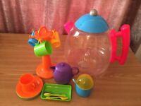 Jug of cups, plates,spoons with mug tree