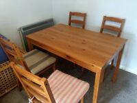 IKEA dining table and 4 chairs with cushions
