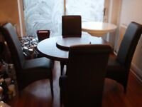Lovely wooden table with four brown leather chairs, excellent condition.