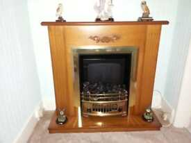 Electric fire, glow effect, immaculate condition of both fire and surround.