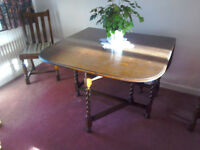 Oak drop leaf dining table and four chairs with matching sideboard