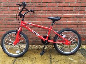 Child's BMX bike in red