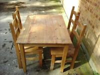 Pine oblong table and 4 chairs