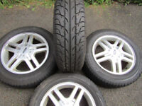 ford alloys 15 inch with new tyres all good condition