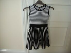 Girls Black & White striped dress. by Lustre .