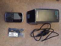 New Blackberry Curve 9320 smartphone with charger and battery